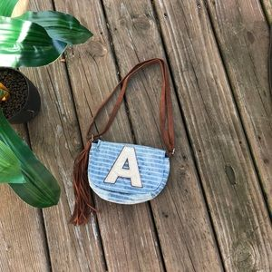 """Justice """"A"""" Crossbody Bag with Tassel"""